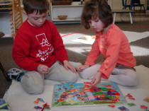 Children Learning with Colorful Geometric Shapes